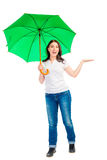 Brunette with umbrella Stock Images