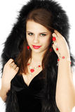 Brunette in un cappuccio della pelliccia Fotografia Stock Libera da Diritti