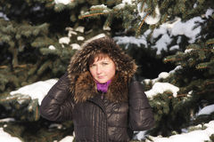 Brunette under big fir tree Royalty Free Stock Photo