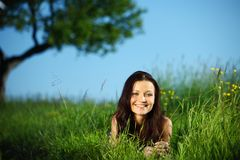 Brunette under tree Royalty Free Stock Image