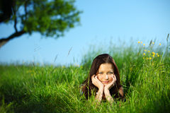 Brunette under tree Royalty Free Stock Photo
