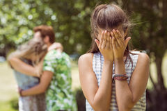 Brunette upset at seeing boyfriend with other girl Royalty Free Stock Photos