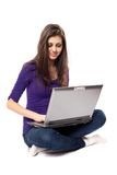 Brunette using laptop Stock Image