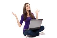 Brunette using laptop. Young beautiful latin brunette using laptop, isolated on white Royalty Free Stock Photo