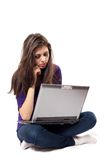 Brunette using laptop Royalty Free Stock Images