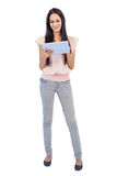 Brunette using tablet pc Royalty Free Stock Photography