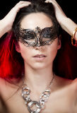Brunette with venetian mask. Stock Images