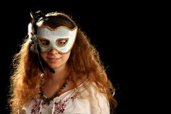 Brunette with venetian mask Royalty Free Stock Images