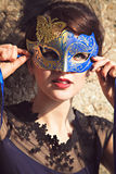 Brunette with venetian mask Stock Photos