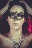 Brunette with venetian mask. Jewelry and Beauty. fashion photo Royalty Free Stock Images