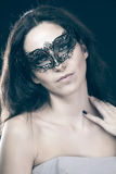 Brunette with venetian mask. sensuality concept Stock Images