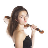 Brunette with violin on shoulder in studio Stock Images