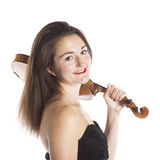 Brunette with violin on shoulder in studio Royalty Free Stock Image