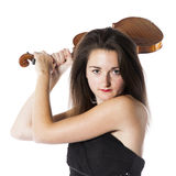 Brunette with violin in studio looks on the verge of hitting Stock Images