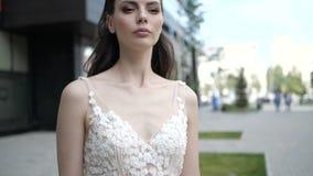 A brunette in wedding dress portrait stock video