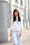 Brunette walking in city Stock Photos