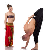 Brunette watches as yoga coach performs asana Stock Photography