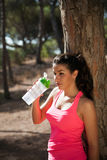 Brunette with water container after sports Royalty Free Stock Image