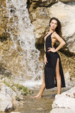 Brunette in waterfall Stock Photo