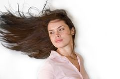 Brunette with waving hair. Pretty brunette in pink topic with her hair nicely waving royalty free stock photography