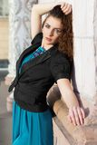 Brunette wearing blue dress Royalty Free Stock Images
