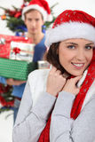 Brunette wearing Christmas cap Royalty Free Stock Photo