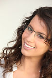 Brunette wearing glasses Royalty Free Stock Images