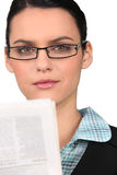 Brunette wearing glasses Stock Photos