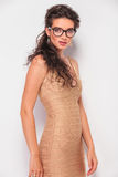 Brunette wearing glasses while posing in studio Royalty Free Stock Photography