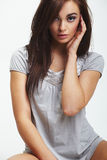 Brunette wearing grey fashion dress Stock Image
