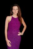 Brunette wearing a purple dress Royalty Free Stock Image
