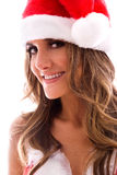 Brunette wearing santa hat. Royalty Free Stock Images