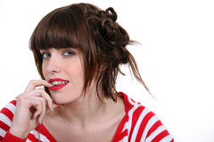 Brunette wearing stripy top Royalty Free Stock Image