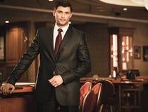 Brunette wearing suit and necktie Stock Photo