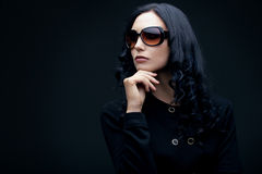 Brunette wearing sunglasses Stock Image