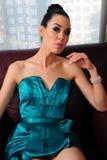 Brunette wearing turquoise dress Stock Image