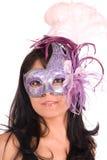 Brunette wearing Venetian mask Stock Photos