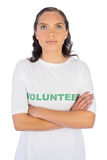 Brunette wearing volunteer tshirt with arms crossed Royalty Free Stock Photography