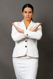 Brunette in a white business suit stock photo