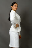 Brunette in a white business suit Royalty Free Stock Photo