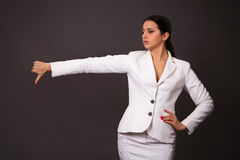 Brunette in a white business suit Royalty Free Stock Photos