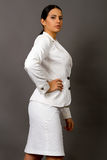 Brunette in a white business suit Stock Image
