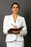Brunette in a white business suit stock photos