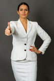 Brunette in a white business suit royalty free stock images