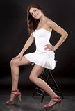 Brunette and  white dress Royalty Free Stock Photos
