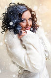 Brunette in white fur coat Royalty Free Stock Image