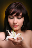 Brunette with white lily flowers Royalty Free Stock Image