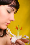 Brunette with white lily flowers Stock Photo