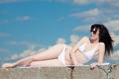Brunette in white on open air Stock Image
