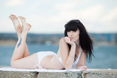 Brunette in white on open air Royalty Free Stock Images